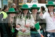 Teenage-girls-celebrate-St-Patricks-Day-Parade,-at-St-Patricks-Day-Celebrations,-Belfast-City-Centre.