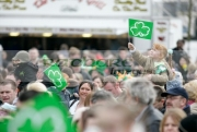 young-red-haired-girl-with-shamrock-flag-in-the-crowd-on-St-Patricks-Day