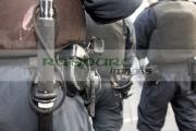 PSNI-Police-Service-Northern-Ireland-riot-control-officer-wearing-baton-handcuffs-glock-pistol-during-disturbance