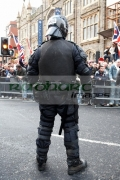 PSNI-Police-Service-Northern-Ireland-riot-control-officer-stands-guarding-during-loyalist-protest-parade-belfast-city-centre