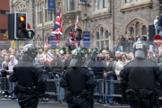 three-PSNI-Police-Service-Northern-Ireland-riot-control-officers-standing-guarding-during-loyalist-protest-parade-belfast-city-centre