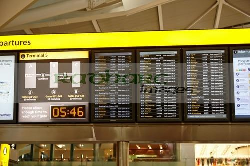 flight information boards London Heathrow Airport Terminal 5 early in the morning UK
