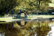 people-fishing-out-walking-the-dog-early-morning-mill-dam-lake-kirkby-Liverpool-England-UK