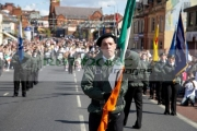 flag-bearing-colour-party-march-along-the-falls-road-on-Easter-Sunday-during-Easter-Rising-Commemoration-Falls-Road-Belfast-Northern-Ireland-UK