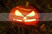 illuminated-halloween-pumpkin-jack_o_lantern-on-grass-at-night