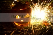 illuminated-halloween-turnip-jack_o_lantern-with-sparkler-to-ward-off-evil-spirits.-Traditionally-in-Ireland-turnips-or-swedes-were-used-to-create-the-lanterns-irish-immigrants-in-america-used-pumpkins-instead.