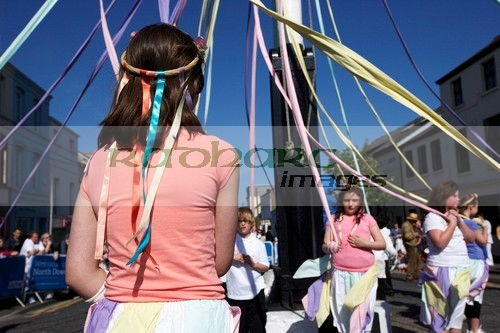 young girls children dancing round a maypole on may day in the uk