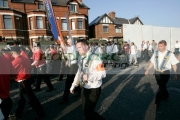 loyalist-marchers-with-band-sword-sashes-on-crumlin-road-at-ardoyne-shops-belfast-12th-July-2005