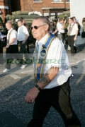 loyalist-marcher-wearing-sash-sunglasses-on-crumlin-road-at-ardoyne-shops-belfast-12th-July-2005