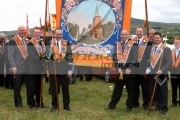 members-loyal-orange-order-orangemen-with-banner-in-field-during-12th-July-Orangefest-celebrations-in-Dromara-county-down-northern-ireland