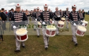 members-loyalist-drum-flute-band-marching-from-the-field-in-uniform-during-12th-July-Orangefest-celebrations-in-Dromara-county-down-northern-ireland
