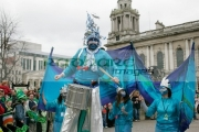 blue-stiltwalker-with-drum-followers-taking-part-in-St-Patricks-Day-parade-in-Belfast-2007