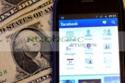 facebook-on-smartphone-cellphone-lying-on-dollar-bills