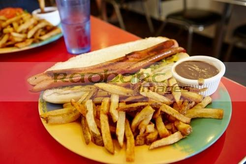 foot long hotdog fries and gravy in a traditional diner Saskatchewan Canada