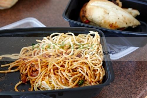 boxed leftovers of spaghetti and sandwich from a restaurant in Saskatchewan Canada