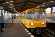 german-u_bahn-underground-train-travels-through-overground-station-Berlin-Germany