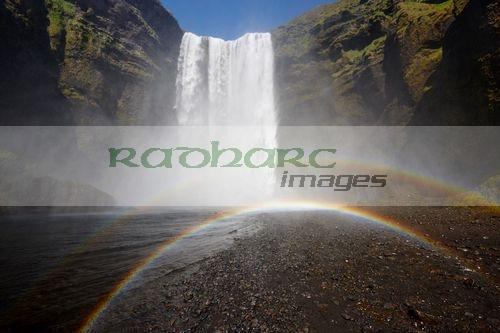 double rainbow in the mist at skogafoss waterfall iceland
