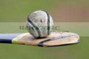 used-leather-sliothar-hurling-ball-balanced-on-hurley-stick-caman