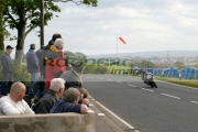 Spectators-watch-the-action-at-Mathers-Cross-at-the-North-West-200-Road-Races-NW200-Northern-Ireland.