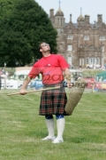 Gregor-Edmunds-from-Scotland-prepares-to-pitch-the-sheaf-at-the-Glenarm-Castle-International-Highland-Games-USA-v-Europe,-Glenarm,-County-Antrim,-Northern-Ireland.