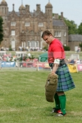 Kyrylo-Chuprynin-from-Ukraine-prepares-to-pitch-the-sheaf-at-the-Glenarm-Castle-International-Highland-Games-USA-v-Europe,-Glenarm,-County-Antrim,-Northern-Ireland.