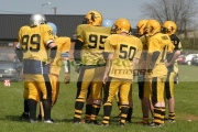 Irish-American-Football-League-Carrickfergus-knights-huddle-before-game-v-University-Limerick-Vikings,-Carrickfergus-25th-April-2004