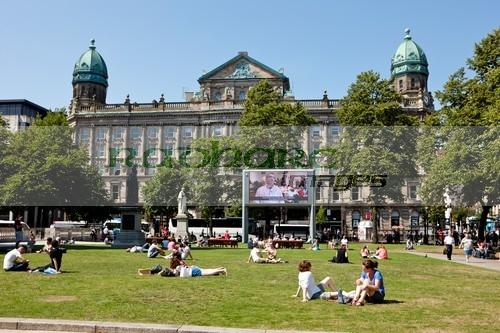 big public screen and historic scottish provident institution from the grounds of Belfast city hall