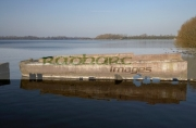 old-submerged-sunken-barge-on-the-shores-lough-neagh-county-armagh-northern-ireland.-These-barges-were-used-to-ship-goods-across-the-lough-through-inland-waterways,-laterly-used-as-sand-barges-they-transported-coal,-turf-guinness.