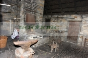 Interior-old-blacksmiths-forge-including-tools-anvil-Bunratty-Folk-Park,-County-Clare,-Republic-Ireland