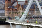 people-crossing-the-new-peace-bridge-in-Derry-city-county-londonderry-northern-ireland-uk.