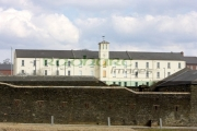 soldiers-quarters-with-clock-tower-defensive-wall-in-ebrington-square-former-ebrington-barracks-british-military-base-Derry-city-county-londonderry-northern-ireland-uk.