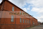 old-red-brick-victorian-british-army-barrack-house-in-former-ebrington-barracks-british-military-base-Derry-city-county-londonderry-northern-ireland-uk.