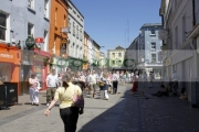 people-walking-down-pedestrian-william-street-past-street-entertainer-Galway-city-county-Galway-Republic-Ireland