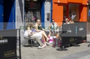 group-young-women-enjoying-sunday-afternoon-drink-outside-Garavans-pub-on-william-street-Galway-city-county-Galway-Republic-Ireland