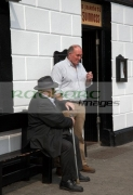 two-old-irish-men-outside-pub-strand-street-in-An-Daingean-dingle-town-europes-most-westerly-town-on-the-dingle-peninsula-county-kerry-republic-ireland
