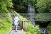 tourists-walking-along-pathway-beside-Glencar-waterfall-county-Leitrim