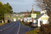 Money-change-bureau-de-change-near-the-irish-border-between-Northern-Ireland-Republic-Ireland-soon-to-be-the-UK-EU-land-border-post-Brexit.-The-building-is-couple-hundred-metres-inside-the-Republic-Ireland-on-the-A1-road-the-former-main-route-between-Belfast-Dublin.-The-border-is-next-to-the-red-fireworks-sign-near-the-middle-the-photo.