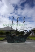 National-Famine-Memorial-the-skeleton-ship-by-John-Behan-beneath-Croagh-Patrick-,-Murrisk-Westport-Clew-Bay,-County-Mayo,-Republic-Ireland.