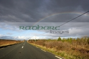 rainbow-over-road-through-bogland-open-rough-ground-in-county-mayo-republic-ireland