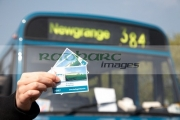 female-hand-with-tickets-to-Si-an-Bhru-newgrange-mercedes-shuttle-bus-between-the-bru-na-boinne-visitors-centre-newgrange,-county-meath,-republic-Ireland