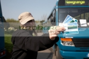 female-tourist-holding-tickets-to-Si-an-Bhru-newgrange-mercedes-shuttle-bus-between-the-bru-na-boinne-visitors-centre-newgrange,-county-meath,-republic-Ireland
