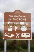 brown-tourist-inishcrone-bilingual-irish-gaelic-english-road-sign-signpost-republic-ireland.-The-sign-shows-the-local-spelling-instead-the-national-inniscrone-or-enniscrone