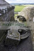 remains-high-stone-celtic-cross-the-OScally-monument-broken-lying-on-the-ground-in-the-Rock-Cashel,-Cashel,-County-Tipperary,-Republic-Ireland