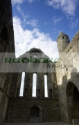 inside-remains-13th-century-cathedral-against-blue-cloudy-sky-in-the-Rock-Cashel,-Cashel,-County-Tipperary,-Republic-Ireland