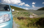 headlight-front-blue-car-parked-in-road-layby-in-the-wicklow-gap-looking-back-towards-glendalough