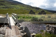new-wooden-bridge-over-small-stream-leading-to-ruined-old-church-next-to-st-kevins-road-in-the-wicklow-mountains