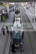 The-LUAS-dublins-new-tram-system-train-parked-in-Connolly-station-shot-from-above-with-people-walking-in-front