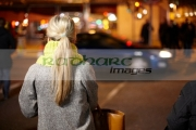 female-shopper-waiting-at-pedestrian-crossing-on-oconnell-street-dublin-republic-ireland