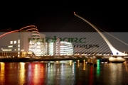 view-the-samuel-beckett-bridge-over-the-river-liffey-the-convention-centre-dublin-at-night-dublin-republic-ireland