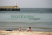 two-children-playing-on-Peel-beach-with-harbour-in-the-background-Isle-Man-IOM